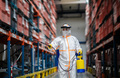 Man worker with protective mask and suit disinfecting industrial factory with spray gun - PhotoDune Item for Sale