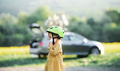 Side view of small girl with bicycle helmet on cycling trip in countryside - PhotoDune Item for Sale