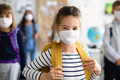 Child with face mask going back to school after covid-19 quarantine and lockdown - PhotoDune Item for Sale