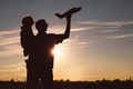 Father and son playing in the park at the sunset time. - PhotoDune Item for Sale