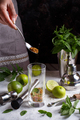 Sifting sugar in a homemade refreshing mojito cocktail - PhotoDune Item for Sale