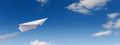 Paper plane in the blue sky. - PhotoDune Item for Sale