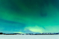 Northern Lights over moon lit frozen Lake Laberge - PhotoDune Item for Sale