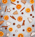 Christmas ginger cookies, dried orange, cinnamon,  and star anise on gray stone background. - PhotoDune Item for Sale