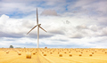 Windmill turbine in a agricultural landscape with fields and meadows. France, Europe. - PhotoDune Item for Sale