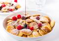 Poffertjes - small Dutch pancakes with fresh raspberries - PhotoDune Item for Sale