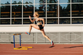 female athlete run 400 meters hurdles - PhotoDune Item for Sale