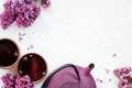 Background with Teapot, Two Cups of Tea and Lilac - PhotoDune Item for Sale
