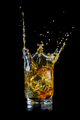 Splashing of whiskey out of glass isolated on black - PhotoDune Item for Sale