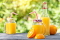 Orange juice and sliced oranges on a wooden table - PhotoDune Item for Sale
