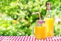 Orange juice in mason jars and bottle on wooden table - PhotoDune Item for Sale