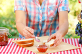 Woman in plaid shirt spreads jam on bread - PhotoDune Item for Sale