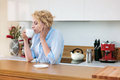 Woman having cup of coffee in the kitchen - PhotoDune Item for Sale