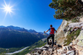 Hiker takes a rest observing a mountain panorama. - PhotoDune Item for Sale