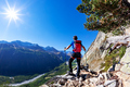 Hiker takes a rest observing a mountain panorama. Mont Blanc - PhotoDune Item for Sale