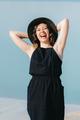 joyous happy girl in a black dress loudly - PhotoDune Item for Sale