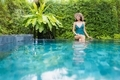 Portrait beautiful young asian woman smile relax and leisure around outdoor swimming pool - PhotoDune Item for Sale