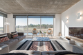 Modern villa living room couch with pool and deck views - PhotoDune Item for Sale