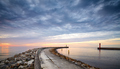 Rocky pier at the entrance to the harbor at sunset. - PhotoDune Item for Sale