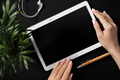 Top view of flat lay of female hand holding tablet - PhotoDune Item for Sale