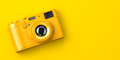 Yellow vintage photo camera on yellow background. - PhotoDune Item for Sale