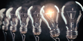Row of light bulb with a one glowing. Idea and innovation concept. - PhotoDune Item for Sale