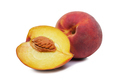 Whole and halved fresh peach showing the pip - PhotoDune Item for Sale