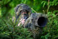 Wildlife photographer in the summer ghillie camouflage suit - PhotoDune Item for Sale