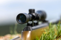 Rifle scope on the street with blurry background. Hunting concept - PhotoDune Item for Sale