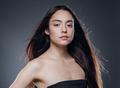 Beautiful woman smooth long hair brunette natural make up beautiful female portrait dark background - PhotoDune Item for Sale