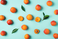 Apricot pattern on blue background. Top view, flat lay. Fresh summer fruit concept. Creative design - PhotoDune Item for Sale