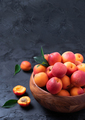 Ripe apricots on black background. Top view, copy space. Fruit banner. Healthy vegetarian food - PhotoDune Item for Sale