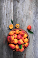 Ripe apricots with leaves on wooden background. Top view, copy space. Fruit banner. Healthy - PhotoDune Item for Sale