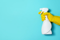 Hand in glove holding white plastic bottle of cleaning product, household chemicals. Copy space - PhotoDune Item for Sale