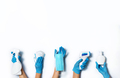 Raised hands in medical gloves holding masks, sanitizers, soap, non contact thermometer on white - PhotoDune Item for Sale