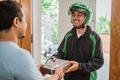 uber driver courier delivering gift box - PhotoDune Item for Sale