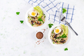 Breakfast oatmeal porridge with green herbs of mushrooms, boiled egg, avocado - PhotoDune Item for Sale