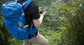 Hiker using smartphone on forest mountain top - PhotoDune Item for Sale