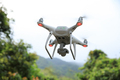 Drone with camera flying in tropical forest - PhotoDune Item for Sale