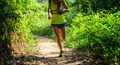 Trail runner running in sunrise tropical forest - PhotoDune Item for Sale