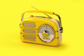 Yellow vintage radio on yellow background. - PhotoDune Item for Sale