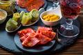 Assortment of tapas and antipasti on black background - PhotoDune Item for Sale