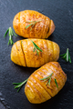 Hasselback potatoes. Backed potatoes from Sweden with garlic and herbs - PhotoDune Item for Sale