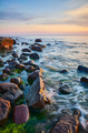 Baltic Sea coast with rocks in water at sunset. - PhotoDune Item for Sale