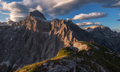 Dramatic sunrise light on the slopes of a mountain - PhotoDune Item for Sale