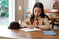 asian girl scout studying at homeasian girl scout studying at home - PhotoDune Item for Sale