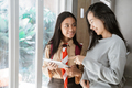 mother daughter using tablet together at home - PhotoDune Item for Sale