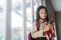 girl wearing scout uniform studying and using mobile phone - PhotoDune Item for Sale