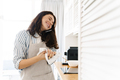 Image of laughing woman talking on cellphone while cooking pie - PhotoDune Item for Sale