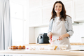 Image of caucasian smiling woman preparing dough for sweet pie - PhotoDune Item for Sale
